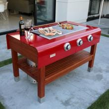 Rockwell By Caliber 60-Inch Freestanding Propane Gas Grill On Wood Table - Red Rockwell By Caliber 60-Inch Freestanding Propane Gas Grill On Wood Table - Red
