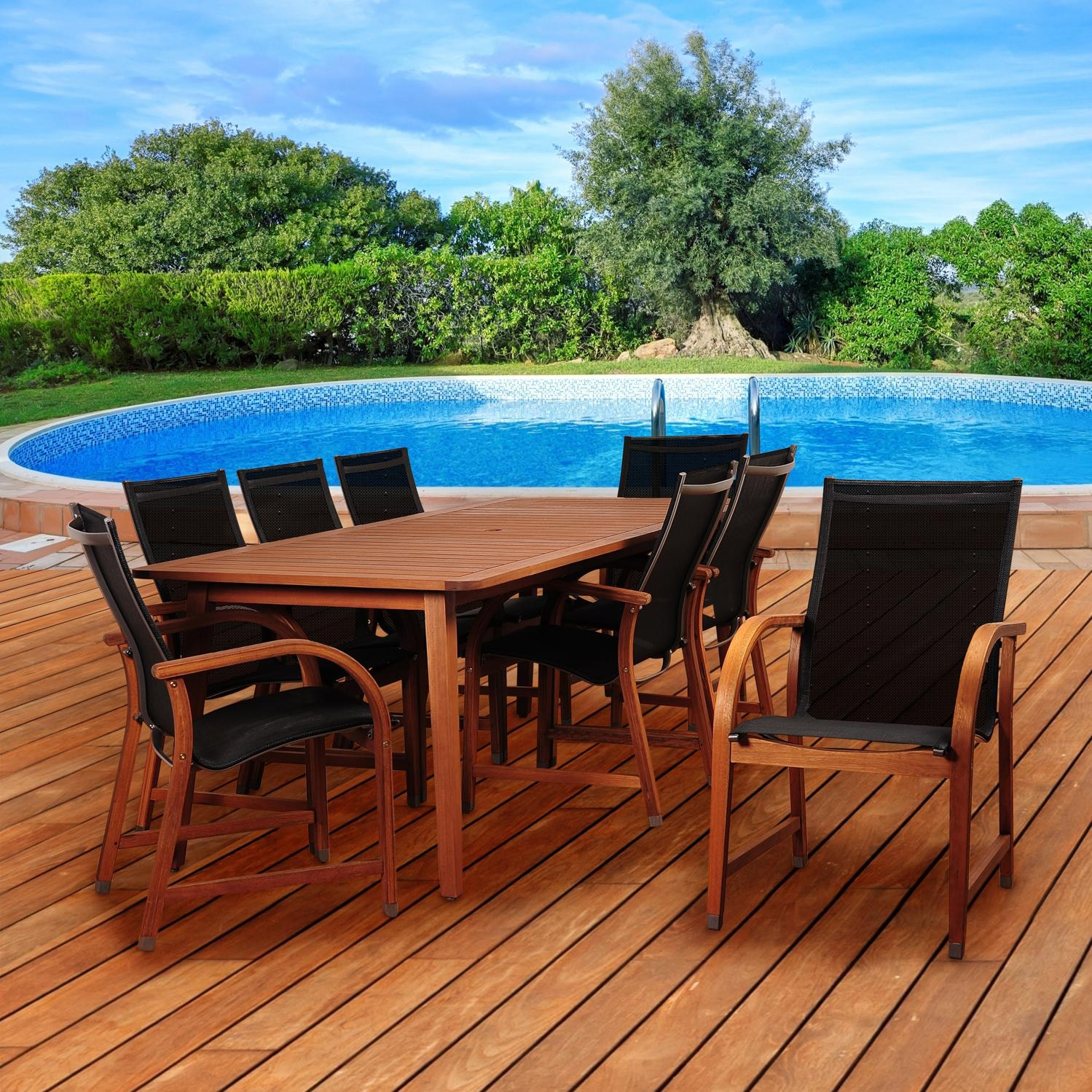 Amazonia SC ARIZ_8MANHA Bahamas 8 Person Eucalyptus Patio Rectangular  Dining Set W/ Black Sling Dining Arm Chair On Outside Deck