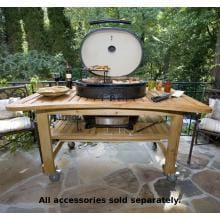 Primo Ceramic Charcoal Smoker Grill On Teak Table - Oval XL Primo Oval XL Ceramic Charcoal Smoker Grill On Teak Table - On Patio
