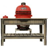 Gourmet Guru Ceramic Kamado Grill On Cypress Wood Vintage Table - Red