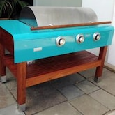 Rockwell By Caliber 60-Inch Freestanding Natural Gas Grill On Wood Table - Turquoise