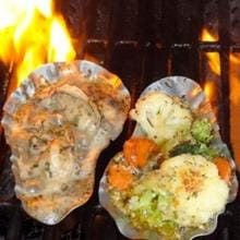 Schwings SOS Reusable Stainless Steel Oyster Shells - 12 Pack Schwings SOS Stainless Steel Oyster Shell - On Grill With Oyster and Vegetables