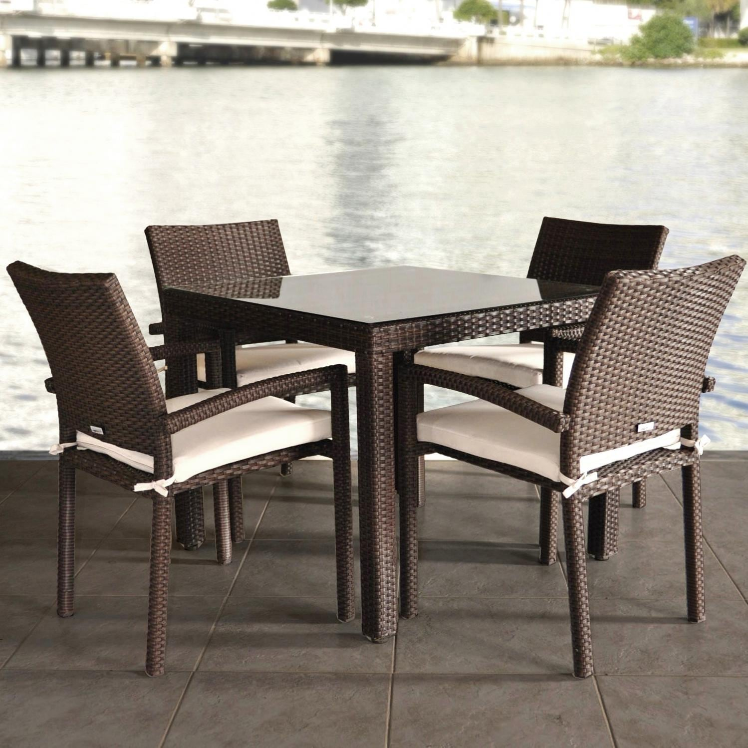 Atlantic liberty 4 person resin wicker patio dining set with glass top table and stacking chairs bbq guys