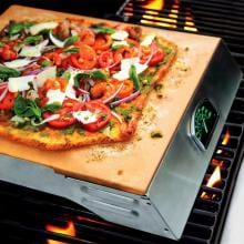 Man-Law 14 X 17 Inch Pizza Stone And Rack With A Glow In The Dark Thermometer Man-Law  Pizza Stone And Rack With Glow In The Dark Thermometer - On Grill