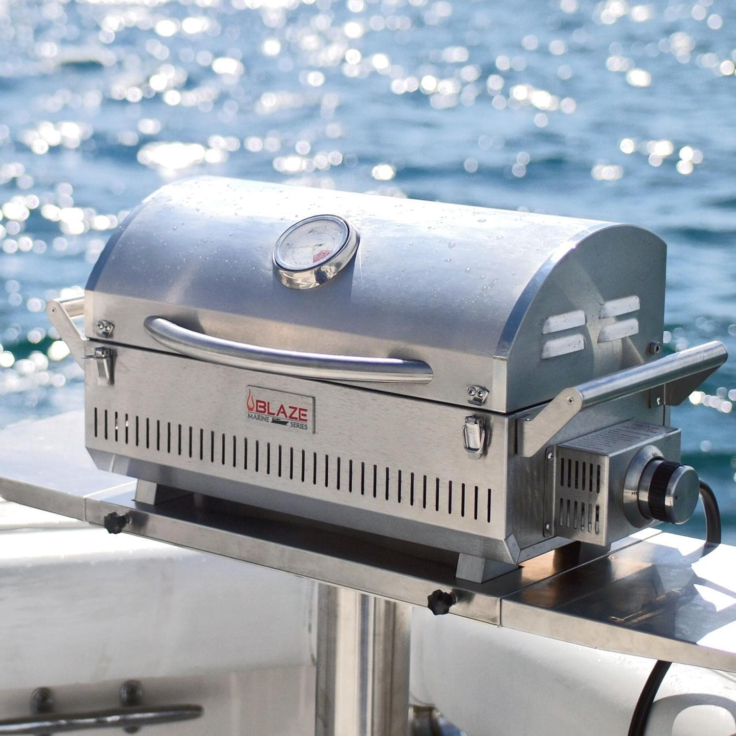 Blaze Professional Marine Grade Portable Propane Gas Grill - BLZ-1PRO-PRTMG-LP Some scratches on the hood. The left side of the body/cookbox is dented,  where the handle attaches. Damage listed does not hinder use. (Stock# 120637-H)