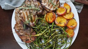 Marinated Pork with Garlic Scapes, Brown Butter & Rosemary Peaches
