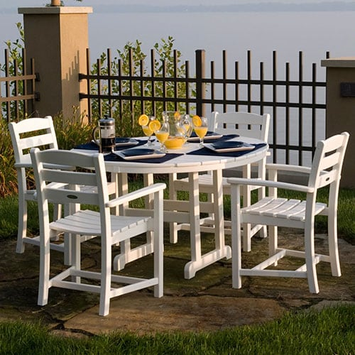La Casa Cafe 5 Piece White Recycled Plastic Wood Patio Dining Set W/ 48 Inch Round Table & Dining Arm Chairs By POLYWOOD