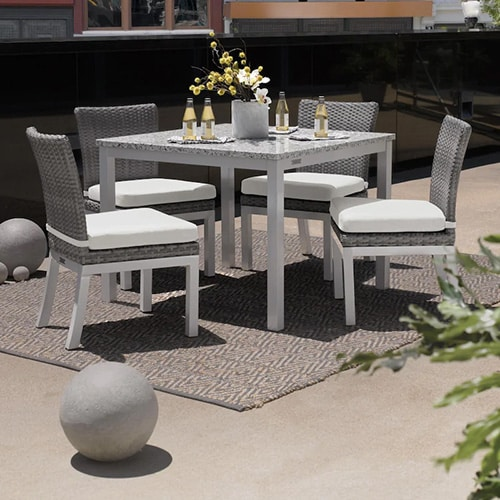 Argento Wicker Patio Dining Set by Oxford Garden