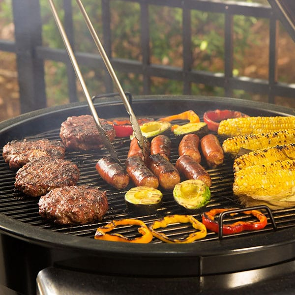 Weber Summit Charcoal Grill with food cooking