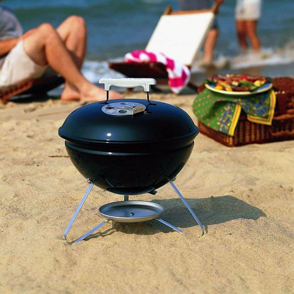 Weber JumboJoe Portable Charcoal Grill on a beach