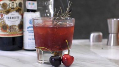 rosemary manhattan with smoked cherries cocktail