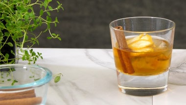 smoked cinnamon old fashioned with orange essence cocktail